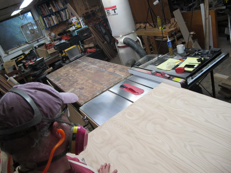 Cutting the 4x8 sheets of ply.